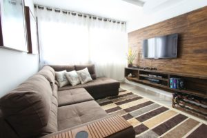 living room with wood wall