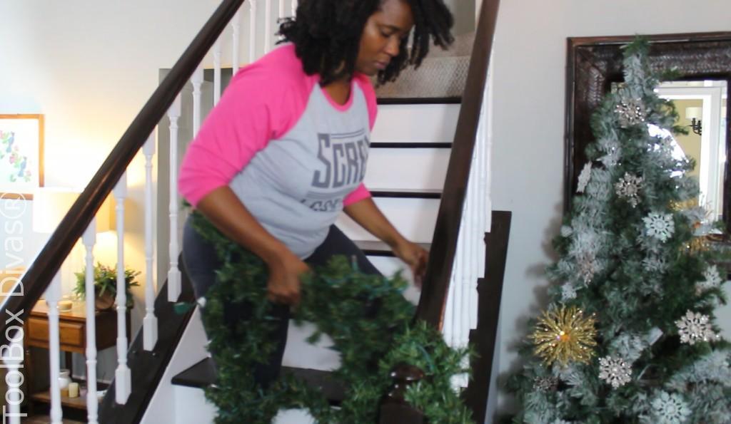 installing garland Christmas wrap lights Christmas Stairs - Toolbox Divas