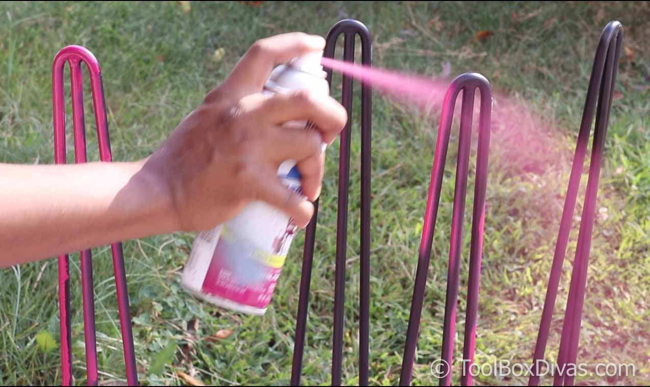 spray painting hairpin legs with pink spray paint