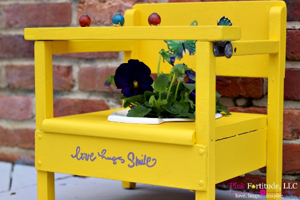 childs yellow potty chair upcycled into a planter