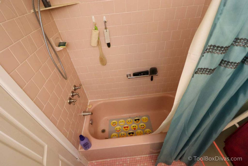pink bathtub and pink tile tub surround