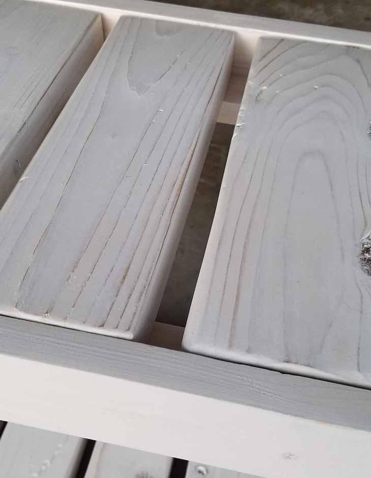 slats of the shelf whitewashed