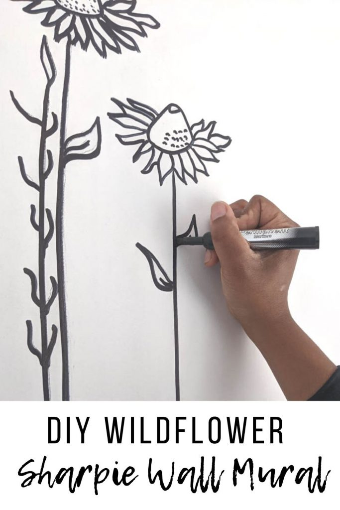 image of drawing a sharpie wall mural with text overlay