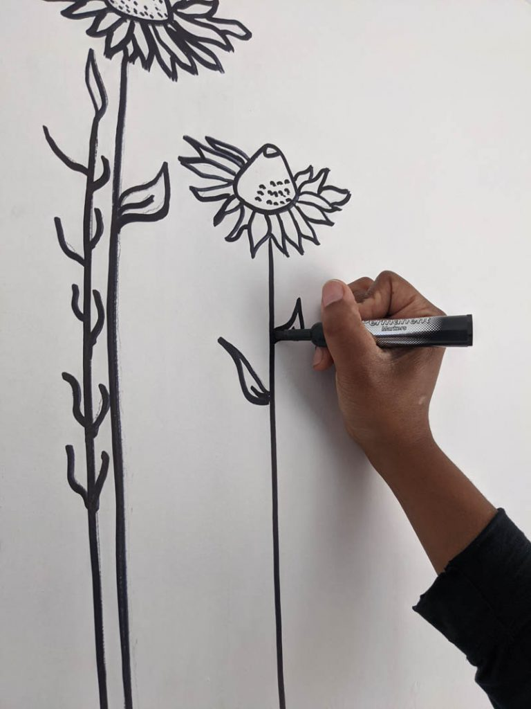 drawing over design with a sharpie