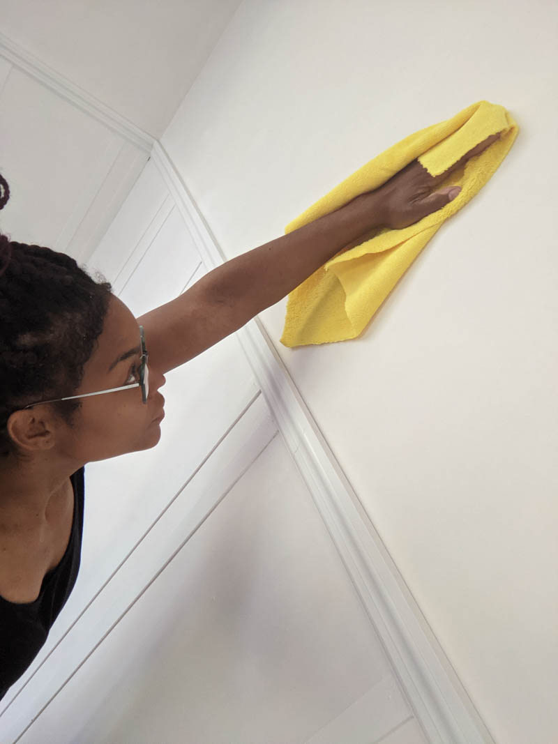 cleaning wall with yellow cloth for sharpie wall mural