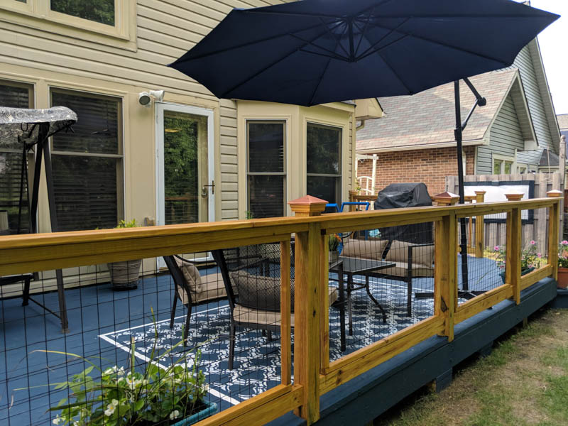 view of painted deck rug through deck railing